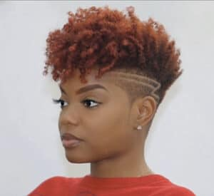 tapered haircut on a woman with an undercut and curly middle part