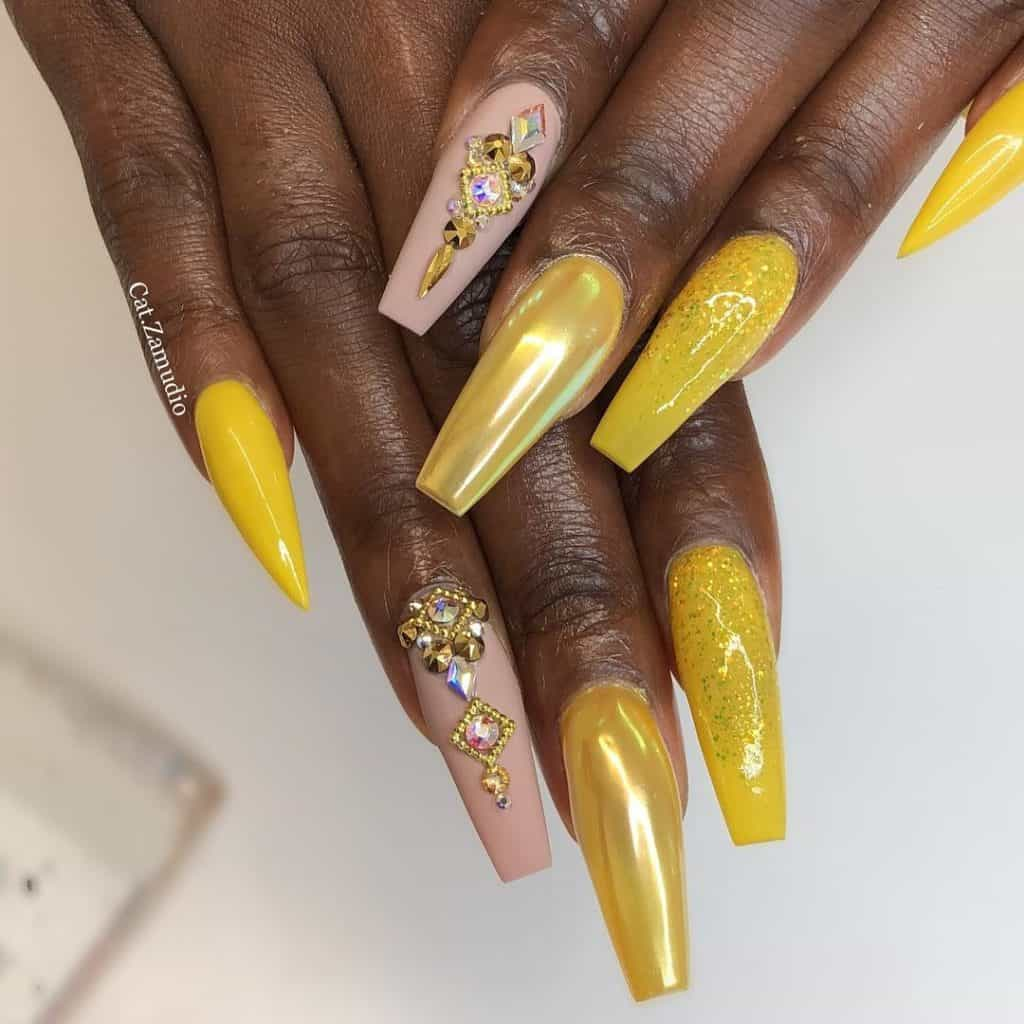 yellow and nude pink acrylics