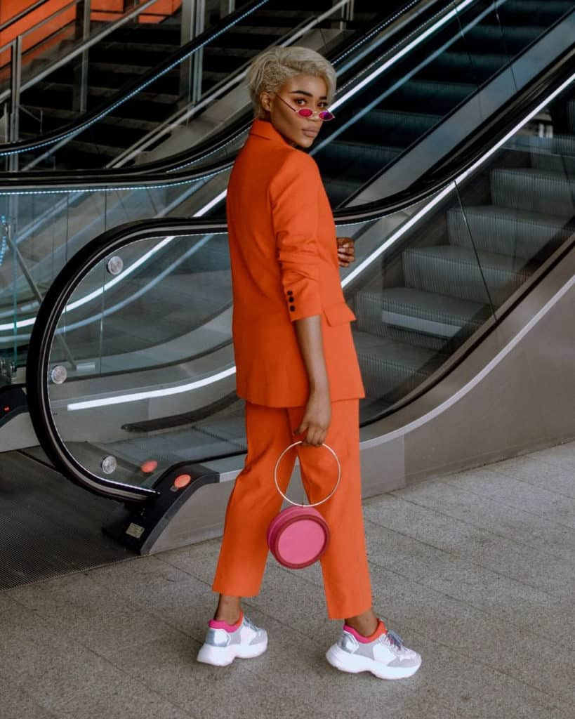 orange pant suit paired with white trainers
