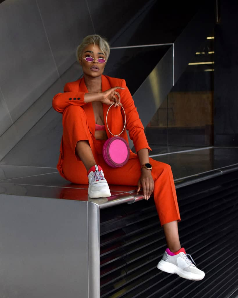 neon orange women's pant suit paired with trainers