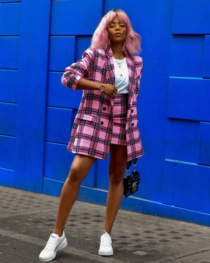 pink plaid blazer skirt suit paired with a white tshirt and white trainers