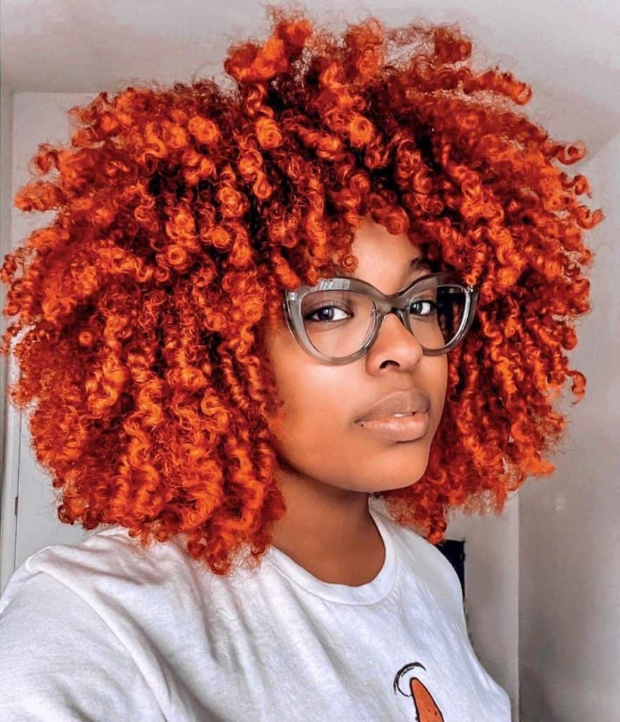 curly afro hairstyle on dyed natural hair