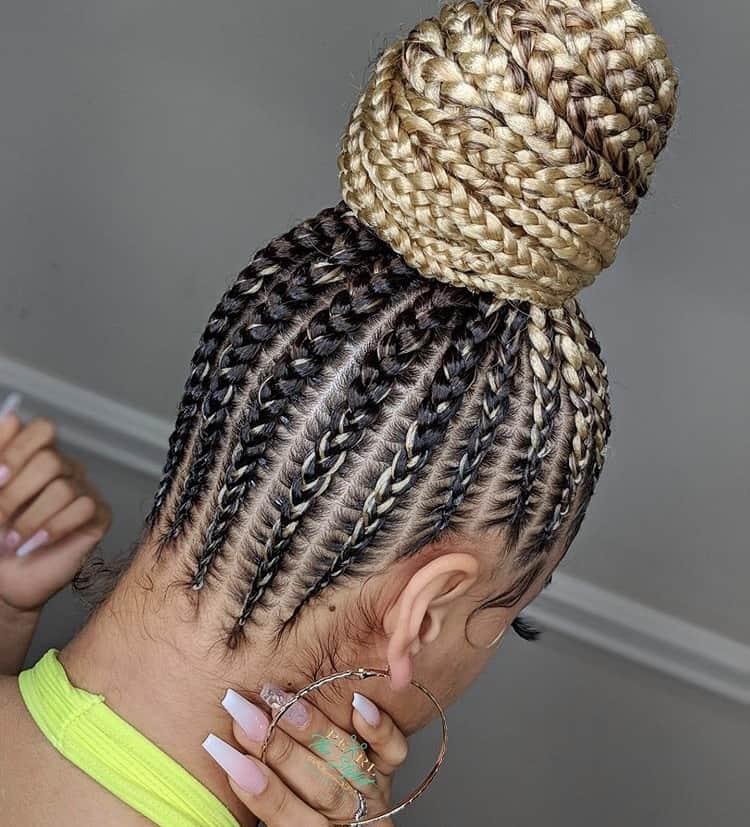 blonde stitch braids in a bun