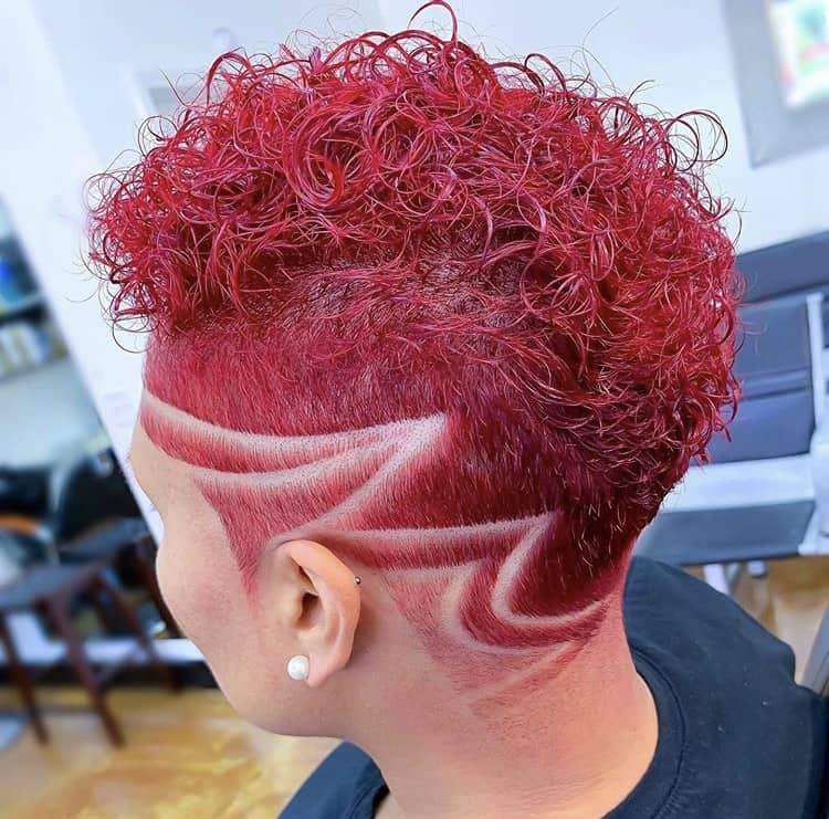 Curly tapered haircut with maroon dye