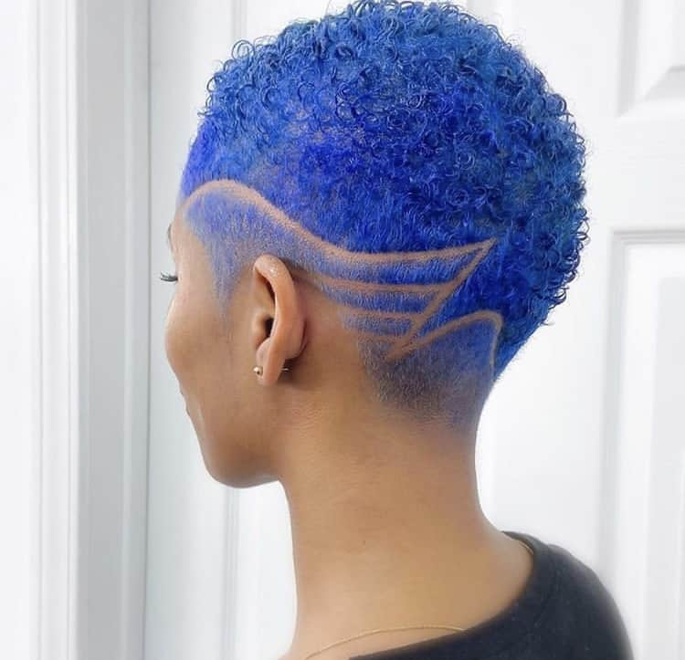 Blue tapered fade haircut with curls