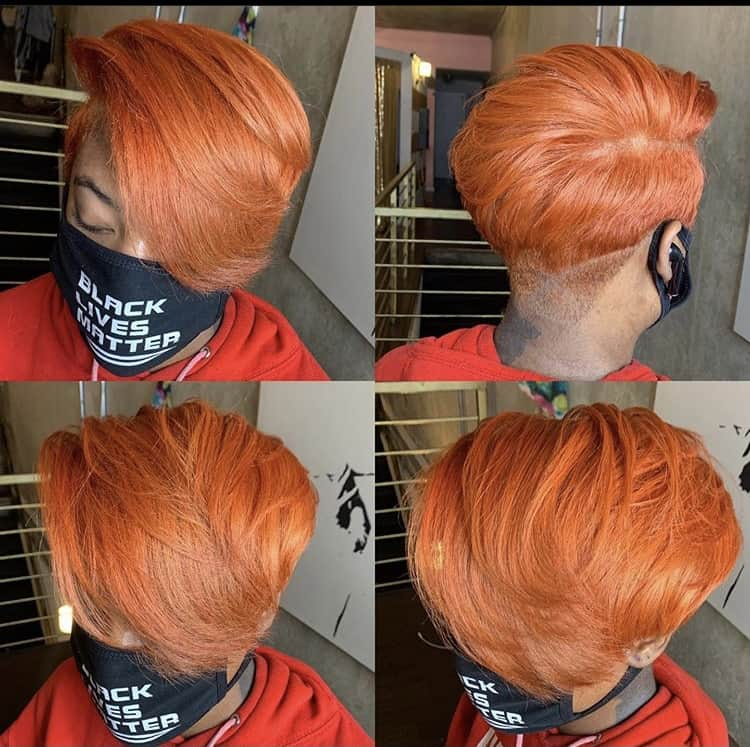 Ginger pixie haircut on a Black woman