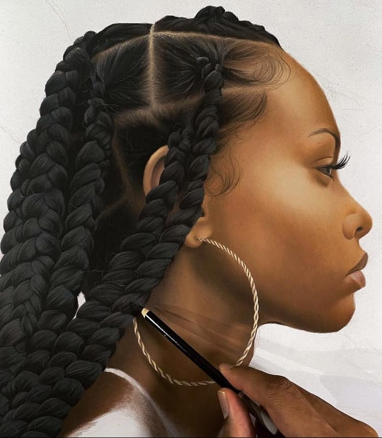 girl with braids drawing